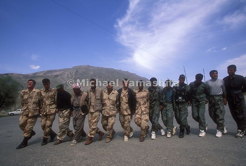 Soldiers, PDK(People's Democratic Kurdistan) Militia dancing. Kurds love to dance.