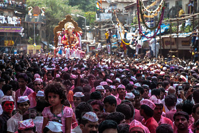 A massive crowd gathers for the culmination of the Ganesh Chaturthi festival in Lalbaug, Mumbai, India. Although Ganesh Chatu...