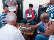 men playing dominoes in Camera do Lobos town square