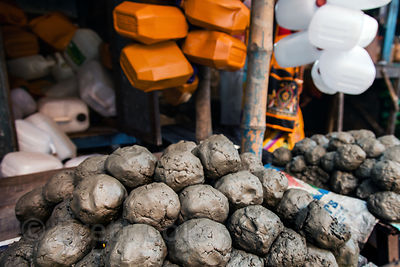 Balls of mud from the Hooghly River for sale at Sovabazar Ghat, Kolkata, India.