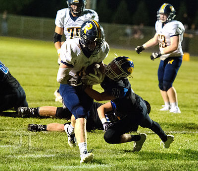 Iowa City Regina's Isaac Vollstedt (44) runs through Wilton's Cory Anderson (11) for a touchdown during the first half of pla...