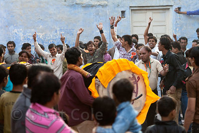 Muslim men play large drums during the Muharram festival, Jodhpur, Rajasthan, India