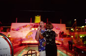 A couple sings at a karaoke party on board the P&O Cruise Liner Oriana