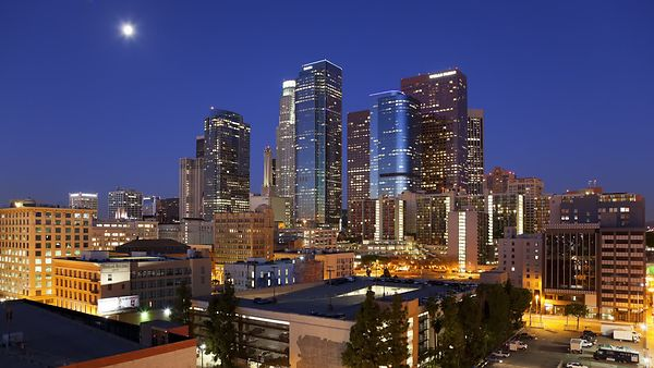 Medium Shot: Setting Moon Gives Way To A New Day In Downtown L.A. (Night to Day)