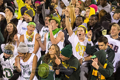 Iowa City West fans celebrate a late fourth quarter touchdown over rival Iowa City High during the Battle for the Boot at Iow...