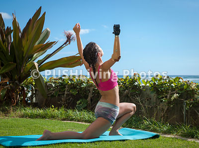 Young woman with a prosthetic arm engaged in a yoga session