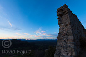 Ruins of Castle of Lluçà (Castell de Lluçà) with the Pyrenees in the background