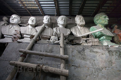 Statues and busts inside a sculptor's workshop in Sovabazar, Kolkata, India.