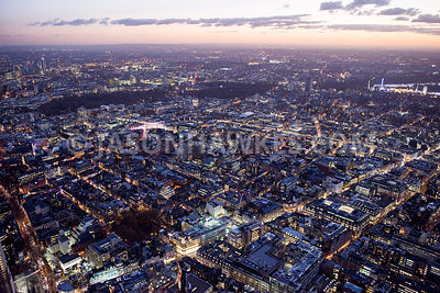 Aerial view of London, Oxford Street towards Hyde Park, Winter Wonderland at night.