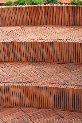 Terracotta tile steps in 'The Garden Lounge' at the RHS Hampton Court Flower Show. © Rob Whitworth