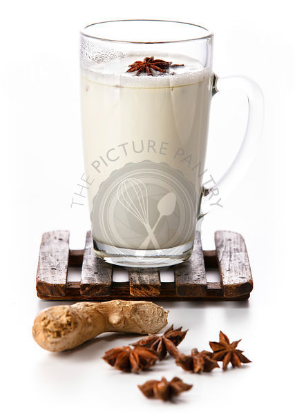 Masala tea with spices on white background