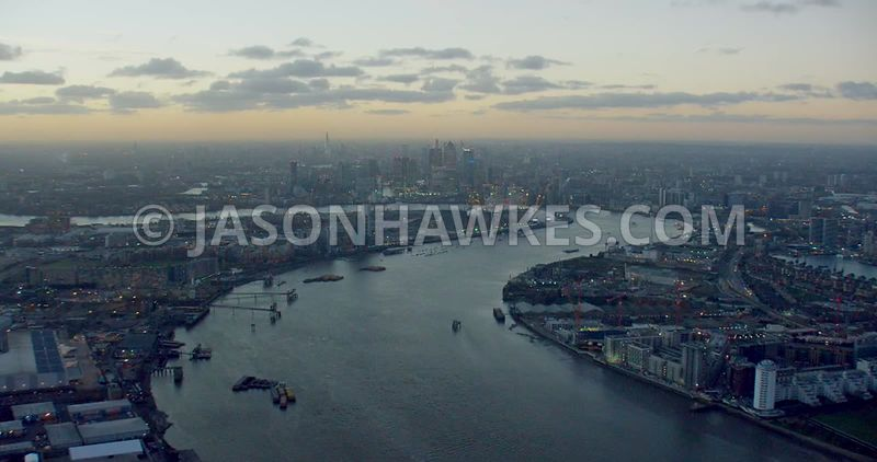 Aerial footage of the River Thames, looking west across Greenwich Peninsula to Canary Wharf