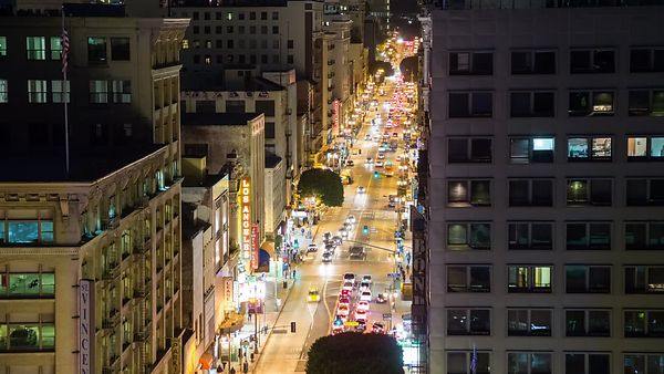 Wide Shot of A Busy Broadway Street in the Evening