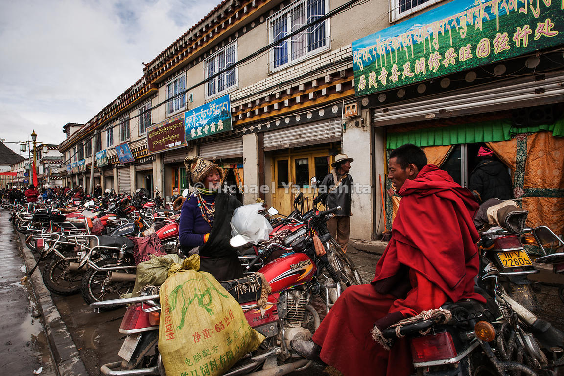 A hundred years ago, Tibetan horses would have been tied up in front of these storefronts in Serxu, but today, the motorcycle...