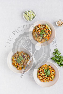 3 bowls of sweet potato noodle pad thai are photographed from the top view.