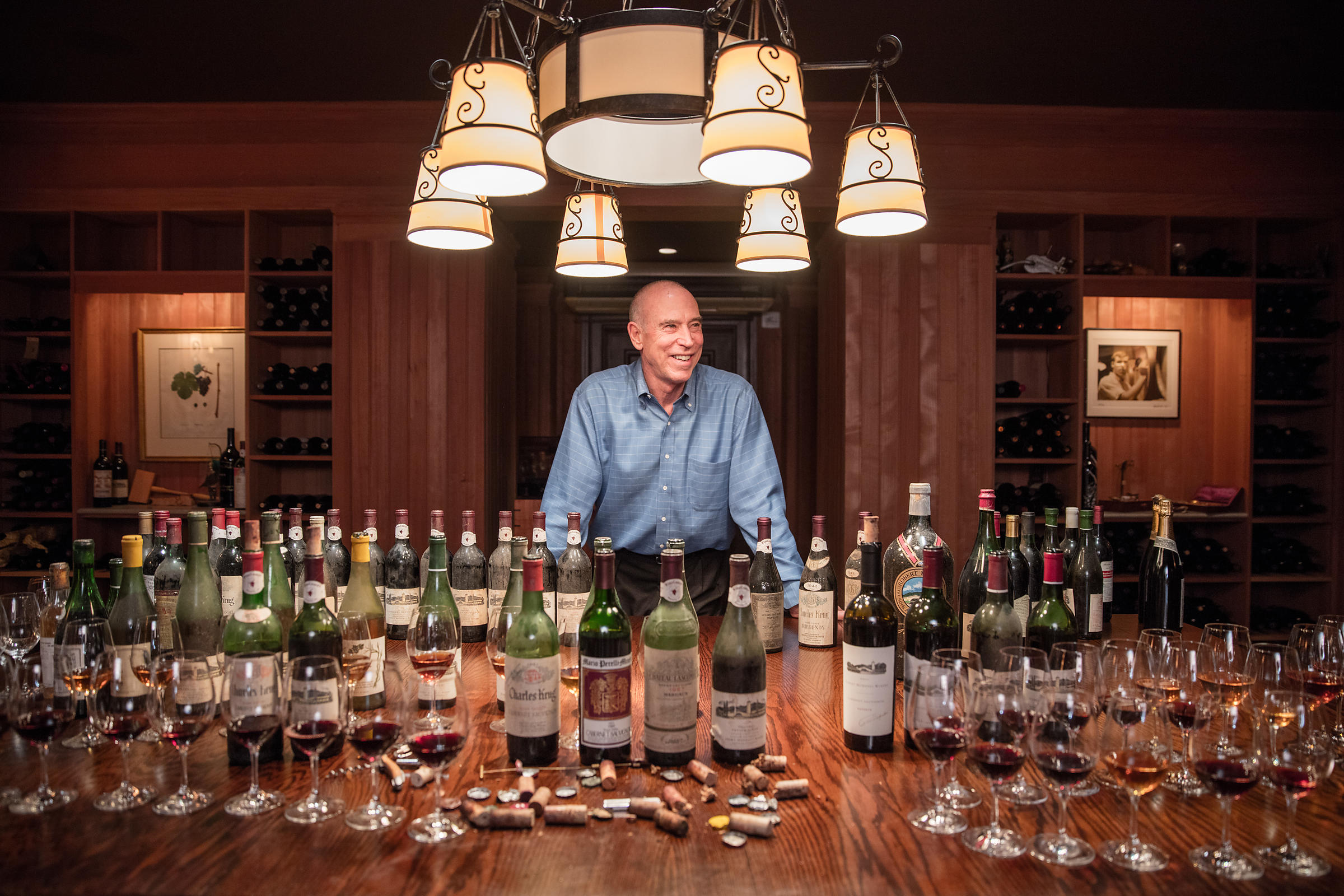Michael Mondavi in his private cellar with several vintage wines photographed for Robb Report by editorial photographer Jason...