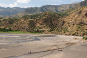 People walking through a riverbed on the way to Ziya market, Ethiopia
