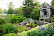 Wooden dovecote stands at one end of the herb garden. Dipley Mill, Hartley Wintney, Hants, UK