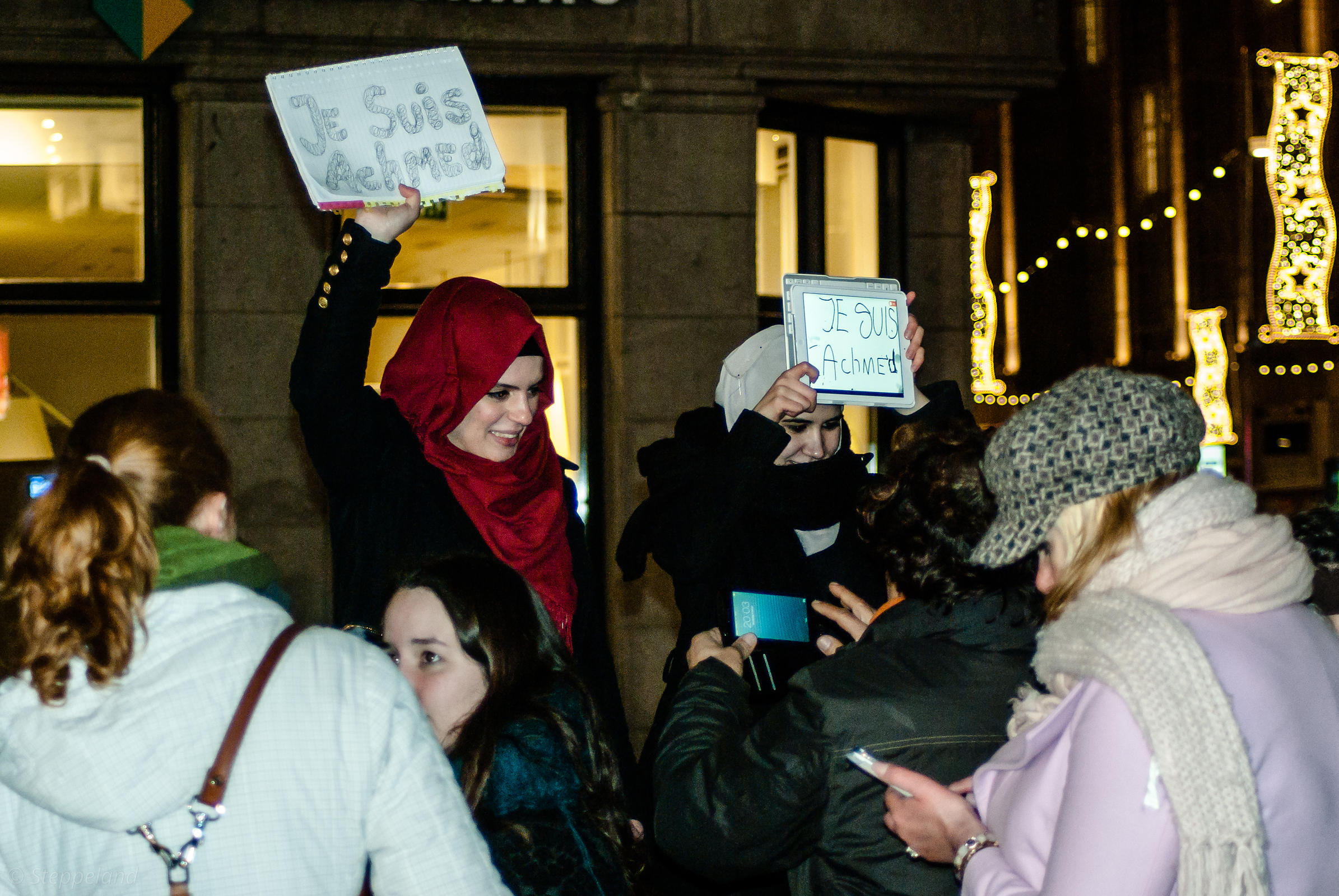 Amsterdam, Netherlands 2015-01-08: Two young woman wearing a Islamic headscarf holding signs 'Je suis Achmed'