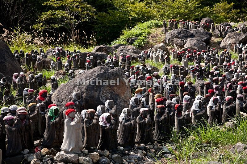 hundreds of statues of babies in hats and scarves called Jizo -.a buddhist shrine near a hot spring where Basho visited telling.of insects were killed by the smell from the nearby sulphur hot.spring.  This shrine is dedicated to children.