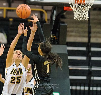Iowa's Kali Peschel (25) defends a shot by Purdue's Ashley Morrissette (1) during the first half of play at Carver-Hawkeye Ar...