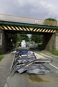 Articulated wagon passing under low railway bridge has roof of trailer ripped off. Kirkby Stephen Cumbria