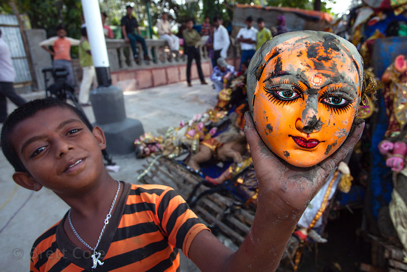 A boy takes the heads off of religious idols at Babughat in Kolkata, India, during the Durga Puja festival. The idols are immersed into the nearby Hooghy River during the festival, but are immediately taken out by the government to avoid polluting the river.