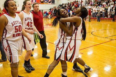 Iowa City High's Kiera Washpun (4) and teammate Ronetta Jenkins celebrate after a win over Waterloo West at the Iowa City Hig...