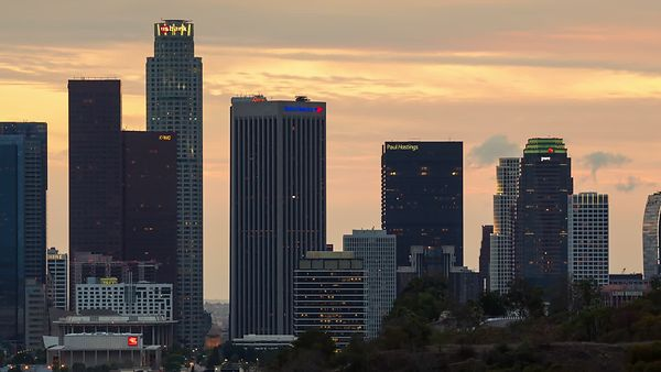Close Up: A Crimson Orange Sunset Decorated With Several Cloud Fronts & High-Rises of Downtown L.A. (Day To Night)