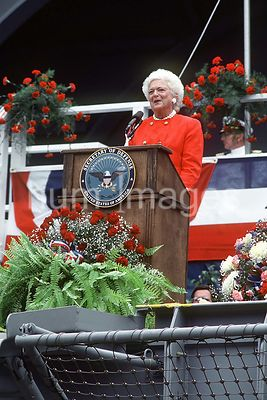 First Lady Barbara Bush, ship's sponsor, speaks during the commissioning ceremony of the nuclear-powered aircraft carrier USS...