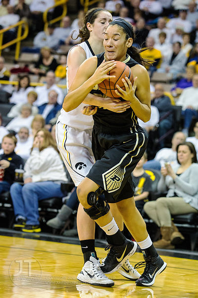 Iowa's Bethany Doolittle (51) fouls Purdue's Whitney Bays (32) during the first half of play at Carver-Hawkeye Arena in Iowa ...