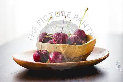 Cherries in a wooden bowl