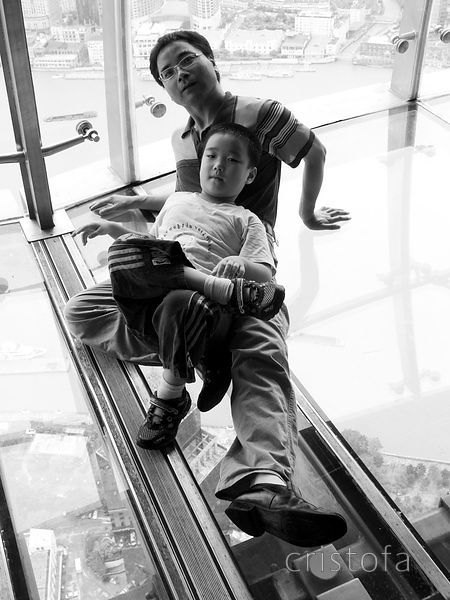 father and son pose in the Oriental Pearl Tower