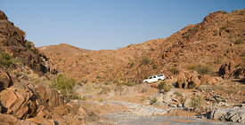 4x4 driving on a dry river bed