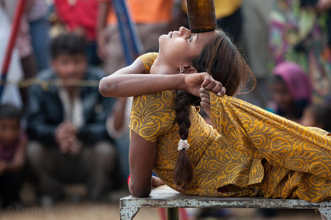 Contortionist girl at a circus show in Pushkar, Rajasthan, India