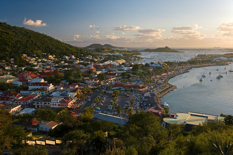 Elevated view over the French town of Marigot at dusk from Fort St. Louis, St Martin, Netherland Antilles, Leeward Islands, L...