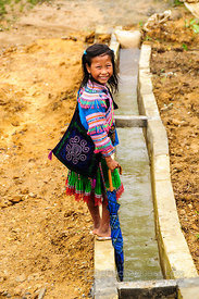 Hmong Girl Next to Irrigation Channel
