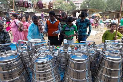 Silver metal tiffin boxes (lunch boxes) at a market, Kullu, India