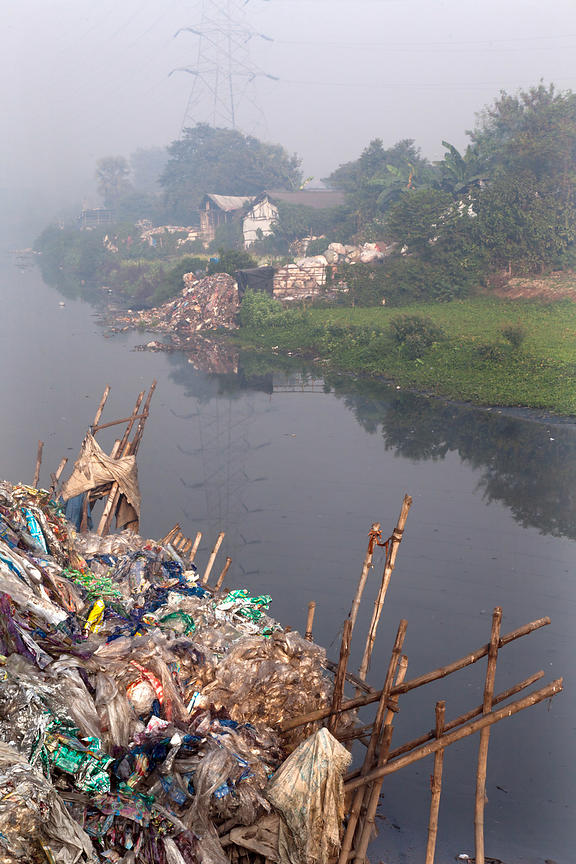 Piles of recycling along a creek in Dhapa, Kolkata, India. Dhapa is the site of Kolkata's main landfill, and a large number o...