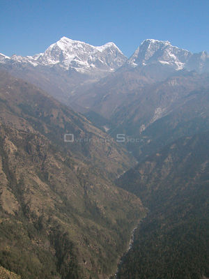 NEPAL Shorong Himal -- 16 Apr 2005 -- Aerial photograph of Mount Numbur (top centre, 6,959m) and Mount Khatang (top centre ri...