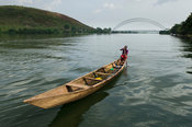 Canoe on the Lower Volta River in front of the suspension bridge, Akosombo, Ghana