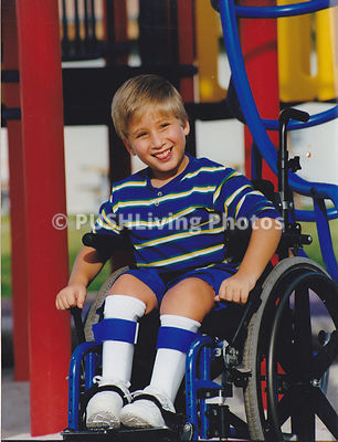 Young boy in a wheelchair in a playground