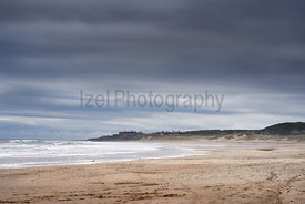 Golden sands of Druridge Bay on a bright bu cloudy day in Northumberland, England.