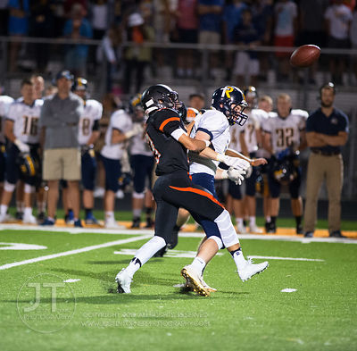 Solon's Jack Stahle (13) deflects a pass intended for Iowa City Regina's Patrick Clark (7) which was then intercepted by Adam...
