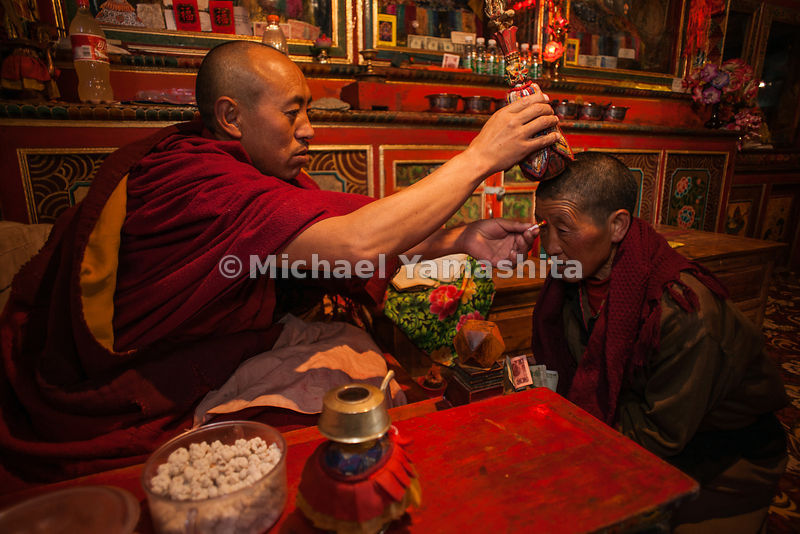A Buddhist nun, who has renounced all worldly things, is anointed in Gandze.