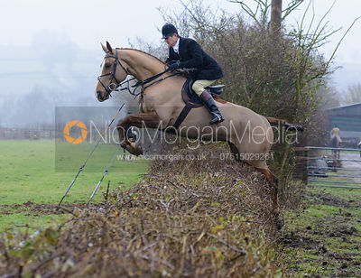 Adam Cooke jumping a hedge at Town Park Farm