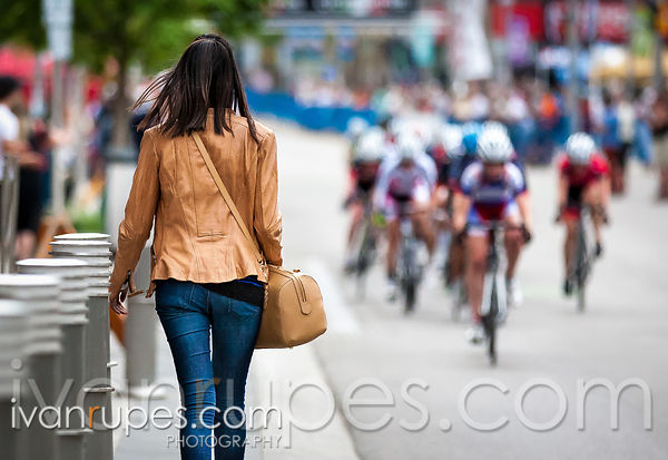 A passer-by at the Kitchener Twilight Grand Prix, Kitchener, On,  June 20, 2014