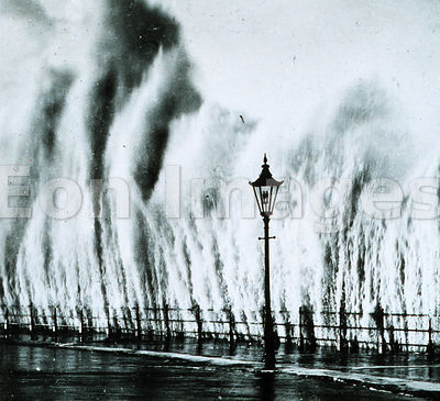 Waves striking sea wall in New England, 1938