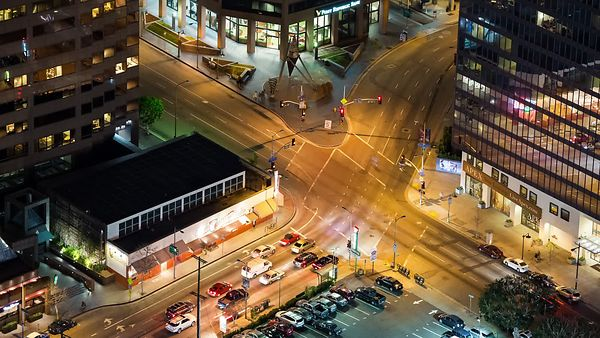 Bird's Eye: Traffic Lights, Traffic, & A Busy Intersection At Night