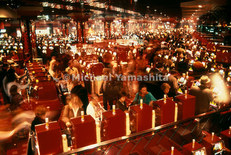 Lured by dreams of fortune, Atlantic City gamblers turn Caesars Boardwalk Regency Hotel Casino into a blur of activity.